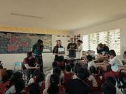 Laura Hosman (center, standing), shows a video from the SolarSPELL library to a classroom of Samoan primary students in May 2017.