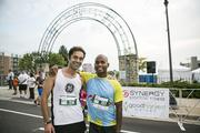 Two of the runners pose for a photo.