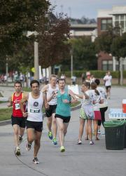 Runners get some water during the race.