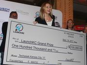 Heather Spalding, co-founder and COO of Kansas City-based Cambrian Tech, accepts the $100,000 grand prize during the LaunchKC awards ceremony.