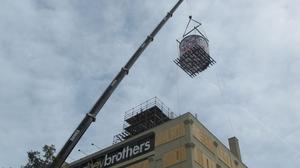 Coakley lifts massive public art piece onto Walker's Point HQ: Slideshow