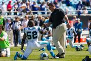 Carolina Panthers head coach Ron Rivera encourages linebacker Jon Beason during pregame warmups on Sept. 22 at Bank of America Stadium.