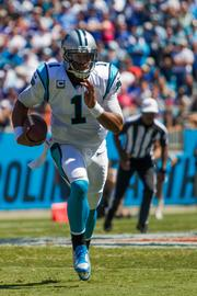 Carolina Panthers quarterback Cam Newton scrambles for a first down. The Panthers beat the Giants 38-0 in Sunday's regular-season game at Bank of America Stadium.