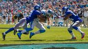 Carolina Panthers tight end Greg Olsen gets tackled near the goal line after making a catch.