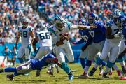 Carolina Panthers quarterback Cam Newton evades tacklers on his way to a first down.