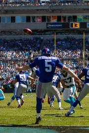New York Giants punter Steve Weatherford kicks away to the Carolina Panthers.