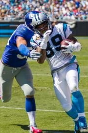 Carolina Panthers wide receiver Steve Smith gets run out of bounds after a long catch-and-run.