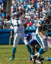 Carolina Panthers quarterback Cam Newton lets fly with a pass that resulted in a touchdown.
