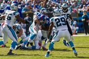 New York Giants running back David Wilson draws heavy attention from Carolina Panthers tacklers.