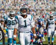 Carolina Panthers quarterback Cam Newton gives a celebratory roar after scoring a touchdown. The Panthers beat the Giants 38-0 in a Sept. 22, 2013, regular-season game at Bank of America Stadium in Charlotte.