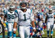 Carolina Panthers quarterback Cam Newton gives a celebratory roar after scoring a touchdown.