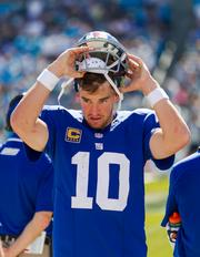 New York Giants quarterback Eli Manning returns to the sidelines in frustration during the fourth quarter of blowout loss.