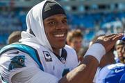 Carolina Panthers quarterback Cam Newton is all smiles after a big win.