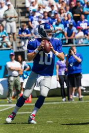 New York Giants quarterback Eli Manning drops back to pass early in a game vs. the Carolina Panthers. The Panthers beat the Giants 38-0 in a Sept. 22, 2013, regular-season game at Bank of America Stadium in Charlotte.
