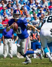 New York Giants quarterback Eli Manning drops back to pass early in a game vs. the Carolina Panthers.