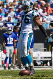 Carolina Panthers defensive end Greg Hardy dances to music being played over the stadium loudspeakers while the New York Giants offense huddles up.
