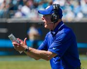 New York Giants head coach Tom Coughlin encourages his team from the sideline.