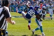 New York Giants wide receiver Victor Cruz is upended by Carolina Panthers cornerback Captain Munnerlyn on an unsuccessful catch attempt.