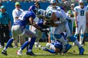 Carolina Panthers tight end Greg Olsen collides with New York Giants safety Ryan Mundy and other defenders after catching a pass.
