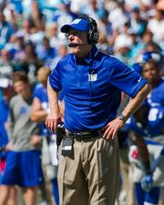 New York Giants head coach Tom Coughlin barks instructions at his team.