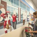 The man who creates each hand-painted Firehouse Subs mural