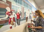 Meet the man who creates each hand-painted Firehouse Subs mural