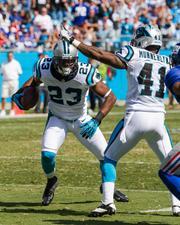 Carolina Panthers cornerback Melvin White turns upfield after making an interception.