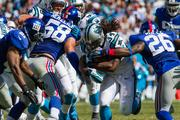 Carolina Panthers running back DeAngelo Williams plows into the New York Giants defense. The Panthers beat the Giants 38-0 in a Sept. 22, 2013, regular-season game at Bank of America Stadium in Charlotte.