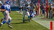 Carolina Panthers running back DeAngelo Williams races for the the end zone while New York Giants cornerback Prince Amukamara closes in to stop him. The Panthers beat the Giants 38-0 in a Sept. 22, 2013, regular-season game at Bank of America Stadium in Charlotte.
