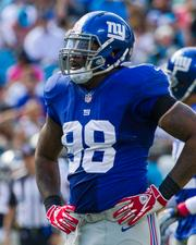New York Giants defensive end Damontre Moore catches a breather between plays.