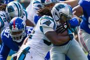 Carolina Panthers running back DeAngelo Williams runs into heavy resistance from the New York Giants defense. The Panthers beat the Giants 38-0 in a Sept. 22, 2013, regular-season game at Bank of America Stadium in Charlotte.