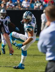Carolina Panthers tight end Greg Olsen makes a diving catch.The Panthers beat the Giants 38-0 in a Sept. 22, 2013, regular-season game at Bank of America Stadium in Charlotte.