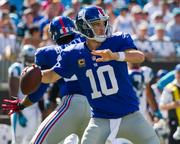 New York Giants quarterback Eli Manning passes downfield.