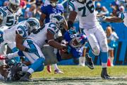 New York Giants running back David Wilson goes down in a gang tackle. The Panthers beat the Giants 38-0 in a Sept. 22, 2013, regular-season game at Bank of America Stadium in Charlotte.
