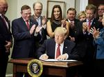 Mass. business owner attends Trump health care order signing