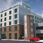 Behind the deal: Parking deck spurs developer <strong>John</strong> <strong>Reece</strong> to enter hotel fray