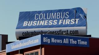 What should be done with the Columbus Business First sign on top of our building?