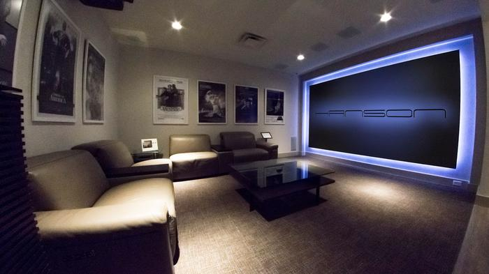 A simulated family room shows off some of the audio and visual equipment Hanson retails.