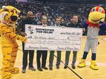 Hurricane relief scores big in KU-MU basketball exhibition