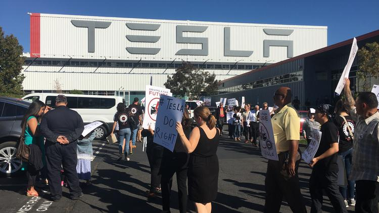Fired Tesla worker sues company, claiming it was a mass