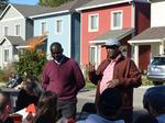 Local execs turn out to help build home for refugee family (Photos)