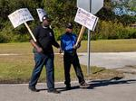 Picketers call on CSX to rollback health care cuts