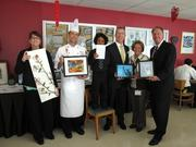 On Feb. 15, the Green Team at Fairmont Washington, D.C., Georgetown, held their seventh annual Earth Art Auction to benefit KEYS for the Homeless. Colleagues created artwork using recycled materials, and the art was displayed in a silent auction in the hotel's cafeteria. Nearly $500 was raised. From left, Pam Knapp of Fairmont; Ian Bens of Juniper Restaurant; Ari Cannon, son of office engineer Raquel Vance; Mark Andrew of Fairmont; Valerie Guste Johnson of KEYS for the Homeless; and Bob Mikolitch of Fairmont.