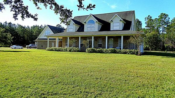 Professional level equestrian estate with custom home for $1,200,000
