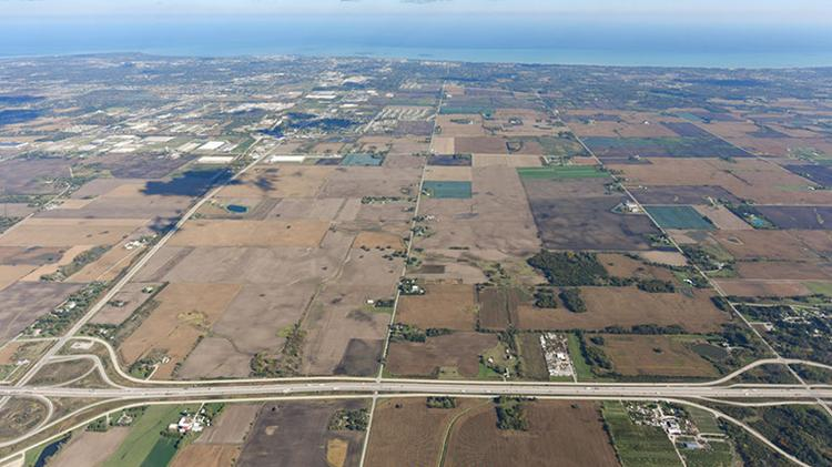 The village spending would help transform farmland east of Interstate 94 into a manufacturing plant with up to 13,000 jobs.