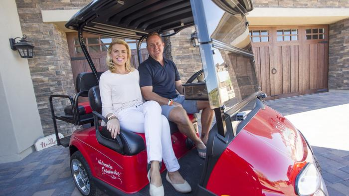 Jim and Julie Prendergast drive their golf cart down their long driveway to stroll around the neighborhood.