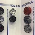 Wheels drive auto industry forward, in showrooms and aftermarket shops