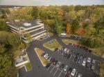 Joss buys 2 suburban office buildings