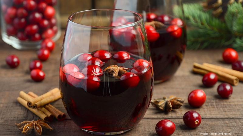 Mulled red wine in a glass on a wooden table