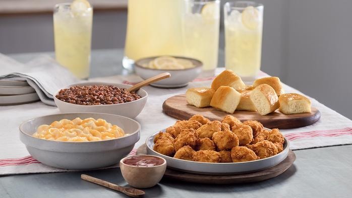 Chick-fil-A extends 'family style' experiment, dropping baked beans and price